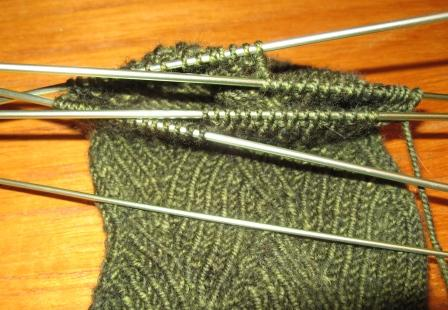 set of 5 green sock needles