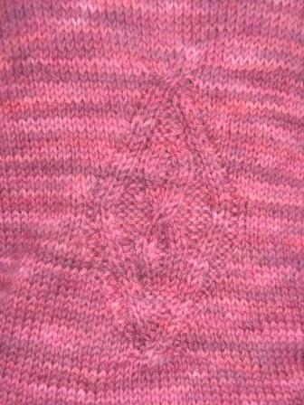 cable detail on Mary's sweater