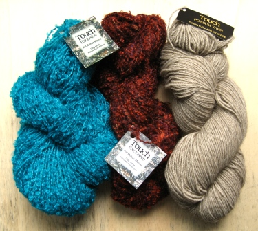 Touch Yarns -- blue boucle, rust boucle, natural possum.